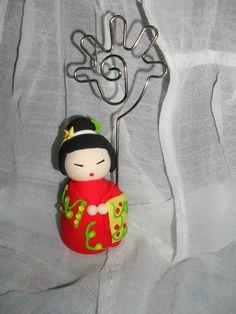 Jumpingclay  Japonesa  in:  http://www.facebook.com/purple.magic.handicraft