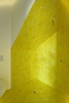 Washing on sunshine ... these bright yellow shower stall scale tiles were designed by Dinosaur Designs duo Louise Olsen and Stephen Ormandy. Photo by Jennifer Soo