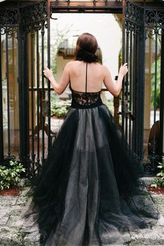 Stunning Black Vera Wang Gown -- See more on Style Me Pretty: http://www.StyleMePretty.com/florida-weddings/miami-fl/2014/03/14/eclectic-garden-wedding-at-villa-woodbine/ Katie Lopez Photography