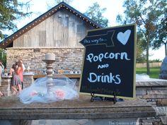 Wedding Sign ~ Popcorn & Drinks this way... #TheGardensofCR #MNWedding Ellie & Trevor at The Gardens of Castle Rock ~ Minnesota Summer Wedding ~ Love Grows at The Gardens of Castle Rock ~ The Minnesota Wedding Venue & Event Center #LoveGrowsatTheGardens #MinnesotaWeddingVenue #MNVenue