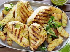 Bobby Flay's Top Recipes -- Grilled Chicken with Roasted Garlic-Oregano Vinaigrette and Grilled Fingerling Potatoes