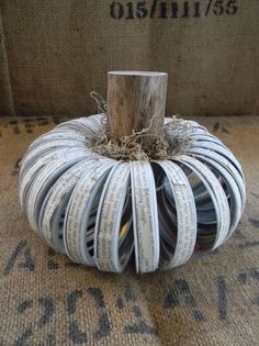 Canning lid pumpkin made with book page text wrap and a tree branch stem
