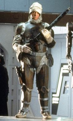 """Dengar: Also known as """"Payback,"""" was a Corellian bounty hunter & the pilot of the Punishing One. Brought up in the culture of swoop bikes & becoming a successful racer himself.  He also led a double life as a successful bounty hunter during the Clone Wars, becoming one of the galaxy's most efficient mercenaries; his work teamed him with the likes of bounty hunters such as Boba Fett and Bossk. Dengar would eventually give up the life of bounty hunting to pursue his other passion: swoop…"""