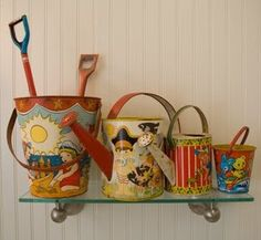 Vintage beach buckets & spades and watering- cans.