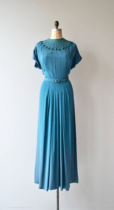 Vintage 1940s teal rayon DuBarry dress with fantastic net & knit neckline, cap sleeves, fitted waist, matching belt, graceful folded skirt at the front center and back center and side metal zipper. --- M E A S U R E M E N T S ---  fits like: large bust: 44 waist: 33 hip: 44 length: 55 brand/maker: DuBarry condition: excellent  to ensure a good fit, please read the sizing guide: http://www.etsy.com/shop/DearGolden/policy  ✩ layaway is available for this item  ...