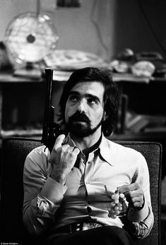 Martin Scorsese with one of the guns used by Robert De Niro on the set of Taxi Driver