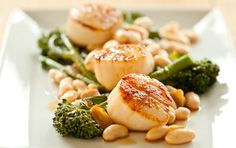 Seared Sea Scallops with Broccoli Rabe and White Beans // The flavors of this dish are simple but superb. To get the best sear on your scallops, be sure to have your pan very hot and make sure the scallops are as dry as possible.
