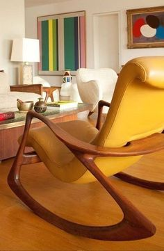 Yellow leather chair I love the rocking chair style of this chair. In a smaller scale, it would make a great kids chair. The yellow and wood matches well together