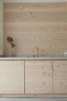 Wooden kitchen units and splashback.