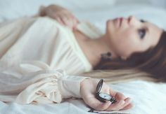 Expectation - Girl with a pocket watch on the bed