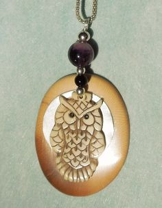 A Composition of Ancient Mammoth Ivory, Bone, Sterling Silver and Amethyst. The Owl and the Moon are movable, Building a Triple Pendant.This piece of Mammoth has a very attractive coloration, acquired during the millennia in the Siberian permafrost. The natural cracks are inlayed with bronze.