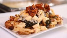Guy savors a combo of collard greens, pork and cheesy mac in Baltimore. Cheese Fries, Collard Greens, Menu Design, Pork Belly, Mac And Cheese, Baltimore, Food Network Recipes, Guy, Business