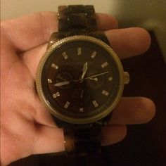 Michael Kors tortoise shell watch Michael Kors tortoise shell watch. Needs new battery but it great condition otherwise! I had links taken out for my small wrist, but all links will be included! Michael Kors Accessories Watches