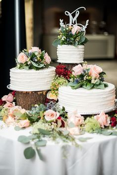 Rustic chic white textured wedding cake trio topped with roses and blue thistle flowers on top of wood logs cake dessert weddingcake flowers rose weddingflowers rusticwedding weddingideas virginia 464644886555657388 Country Wedding Cakes, Small Wedding Cakes, Wedding Cake Roses, Wedding Cake Rustic, Wedding Cakes With Cupcakes, Wedding Cakes With Flowers, Wedding Cake Designs, Wedding Cake Tables, Cake With Flowers