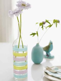 Decorate a bottle with washi tape to make a pretty, easy vase: