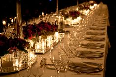 A dinner party table setting. The touches of silver, glass, and candlelight lend such an air of elegance.