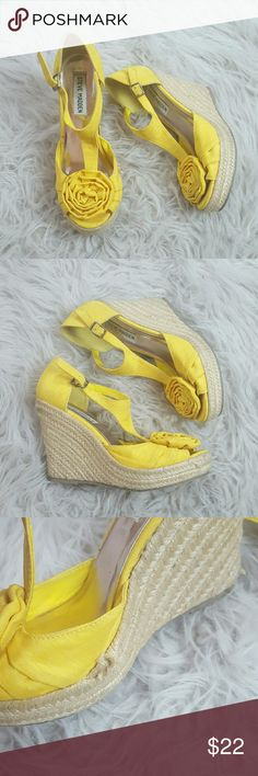 Steve madden yellow flower wedges Size 5.5 so adorable! In good condition, has one small flaw as shown in 3rd photo. Still wearable! Price reflects the flaw! Steve Madden Shoes Wedges