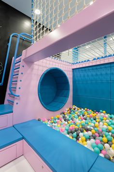 Marat Mazur Has Designed A New Café In Saint Petersburg, Russia - This modern kids play area with a ball pit, seating nook, a chalkboard wall, and a ladder that lead -