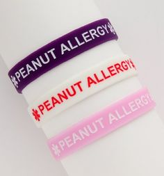 """Kids Peanut Allergy Silicone Wristbands - Lot of 3 by Fashion alert. $7.19. Fun & Functional. Set of 3. Great for Kids Or Small Wrists. 7"""" in Diameter. Peanut Allergy Silicone Bracelets. Sold in a pack of 3. Colors include one of each: Pink, White and Purple. Child's size (7 inches).  A great alternative to the traditional medical bracelet."""