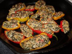 Peppers stuffed w. artichoke spinach and cheesed