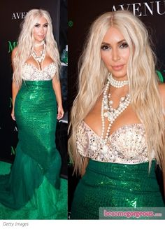 Kim Kardashian as a mermaid....is it just me or does she look like cher?