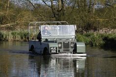 HUE 166 (Huey) the world's oldest Land Rover getting wet!