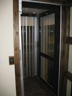 Aluminum and glass elevator cab for a home elevator