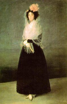 """Francisco de Goya. """"Marquesa de La Solana"""". 1794-95. Museo del Louvre. Paris. La mantilla es de muselina blanca con cerco de festón en zigzag. Se adorna la cabeza con una gran moña de color rosa. La mantilla cae sobre los hombros y se recoge en forma de chal."""