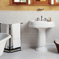 White subway tiles are a classic choice for any design style. But have you considered shaking up your design with a handcrafted look or beveled tiles? Check out our idea book for subway tile inspiration! Bathroom Tiles Pictures, Bathroom Tile Designs, Bathroom Floor Tiles, Bathroom Ideas, Bathroom Wall, Bath Ideas, Bathroom Inspiration, Bathroom Trends, Shower Tiles