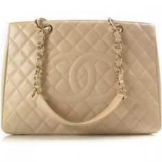 This is an authentic CHANEL Caviar Grand Shopping Tote GST Beige Clair.   The exceptional quality and bold features of this Chanel tote lend a look of casual elegance for everyday.