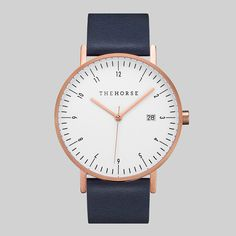 The Horse D-Series Rose Gold & Navy Leather Strap Watch: Boasting strong technical ability with Swiss quartz movement, and a handy date display, the satisfying weight of the D-Series comes from its polished stainless steel casing. Six screws along the backing further the protection of the interior mechanism. The elegant case has a scratch-resistant mineral lens to ensure it's sleek looks will withstand everyday wear.