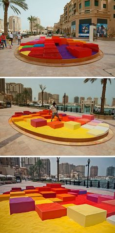 Polish artist Adam Kalinowski, has created an interactive art piece named 'The Dream City'. Made from 30 tons of colored sand and plywood, it was installed in Doha, Qatar.: