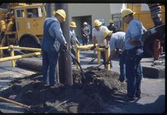 City Light workers installing utility pole, 1967