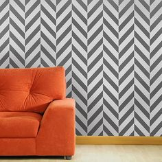 this herringbone wall makes my eyes hurt… lucky for me there's that comfy orange couch to sit and rest on