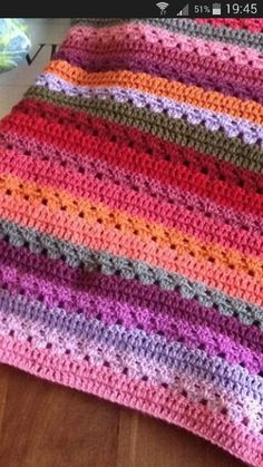Nice blanket. No written pattern, but it's two rows granny stripes and two rows DC.