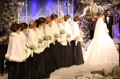 Black long bridesmaid dresses with white fur. Perfect for a winter wedding!