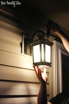Put in some new porch lights. | 39 Budget Curb Appeal Ideas That Will Totally Change Your Home