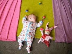Sleeping baby juggling in the circus