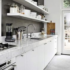 All White with minimalist charcoal backsplash
