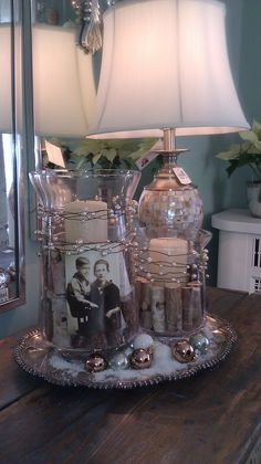 DIY center piece idea...glass jars/vases with photo, wood and candles wrapped in twine or garland on silver serving plate...I know the current photo used in this pin is a little creepy, but imagine a ridiculously cute photo of you and Will.