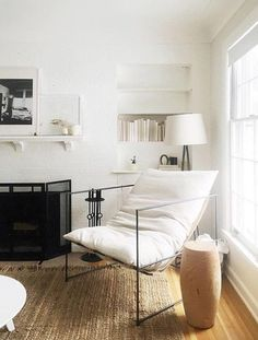 simple white living room with black and wood details. / sfgirlbybay