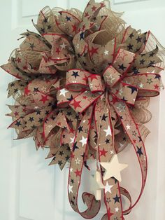 This patriotic Wreath is made of poly jute deco mesh and accented with canvas tan ... red white and blue Stars ribbon. I also used a canvas ribbon