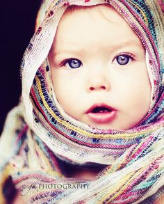 Simplest idea can be the cutest one... Wrap a colorful scarf----prettiest baby alive maybe