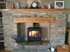 Esse oak fireplace beam with matching mantel and reclaimed Yorkshire stone hearth. Fireplace Beam, Fireplace Inserts, Fireplace Surrounds, Fireplace Design, Bioethanol Fireplace, Fireplace Kitchen, Inglenook Fireplace, Wood Stove Surround, Wood Stove Hearth