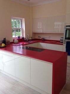 Royal Red Corian Worktops Designed by Buildbase Oxford & Fabricated by Counter Production Ltd www.counterproduction.co.uk