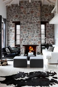 If that was exposed brick instead of random rocks, this living room would be the perfect blend of modern and vintage