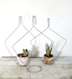 #RECYCLED WIRE COATHANGERS -#succulents in hangers made of recycled coathangers.  #Wire Hanger alteration would not be that hard to work out with a pair of long-nose pliers.  Make this for gifts or for yourself.