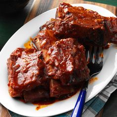 Farm-Style BBQ Ribs Recipe -Inspiration struck when I saw a recipe like this one in a newspaper. My version was an instant hit with my husband and friends. It got even better when I discovered how easy it is to make in the slow cooker. —Bette Jo Welton, Eugene, Oregon