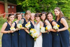 "These maids are the perfect ""something blue""  #brideside #realwedding #wedding #navy #blue #bridesmaids #weddingparty #fashion #bride  A New England wedding with pops of yellow and coastal flair 