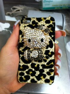 Cheetah print AND Hello Kitty cell phone cover .